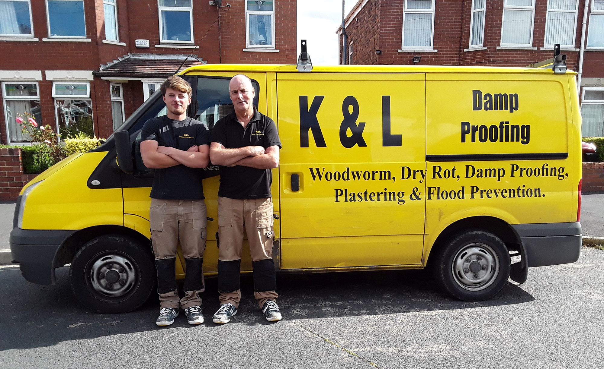 Workers standing next to K&L van